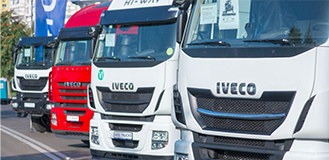 Front of trucks aligned at an angle with Iveco name on them