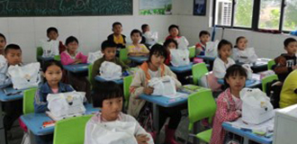 Classroom at Wangjian Primary School in China with children sitting at desk with Panduit health packages